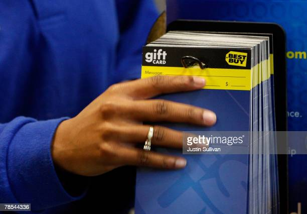 Best Buy employee pulls a gift card from a display rack December 18 2007 in San Francisco California Consumer electronics retail giant Best Buy Co...