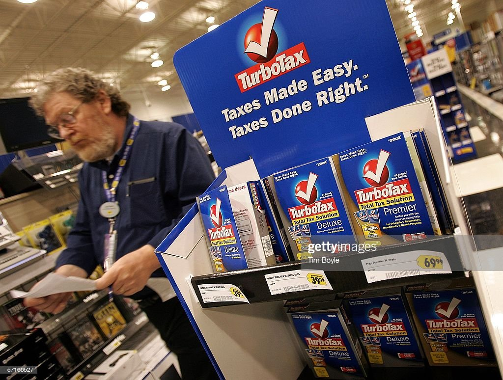 A Best Buy employee walks past a display for TurboTax software in a Best Buy store March 23, 2006 in Niles, Illinois. As next month's income tax deadline approaches, Americans are preparing for it by using tax software, filing out paper forms or by using a tax preparer.