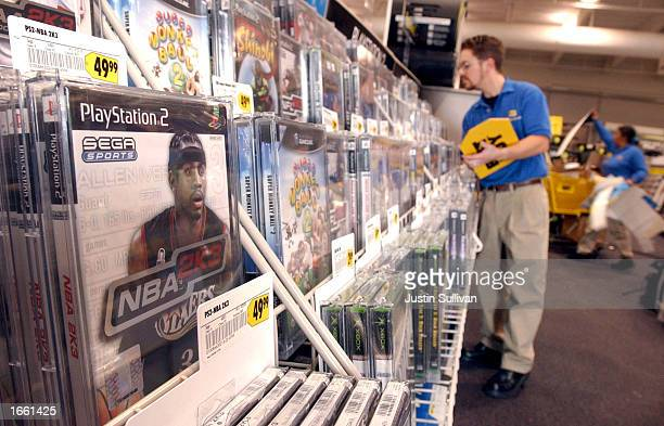 Best Buy employee Walter E Guenther takes inventory of video game stock November 26 2002 in Marin City California It is estimated that one third of...