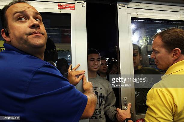 Best Buy employees let in some of the first shoppers on November 23 2012 in Naples Florida Although controversial many big retail stores have again...