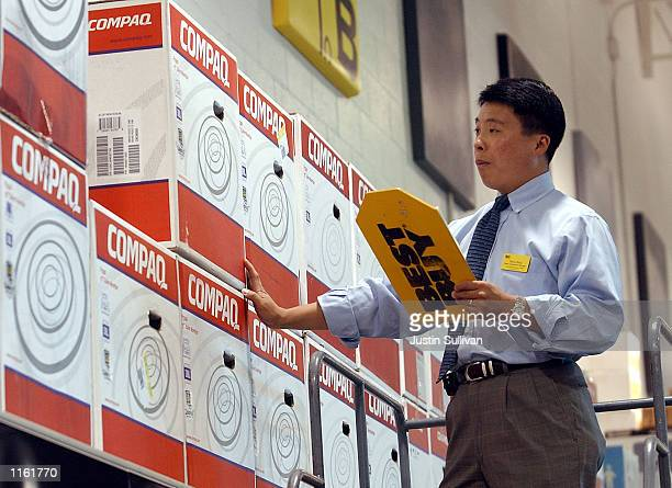 Best Buy store manager Danny wong checks inventory of Compaq computers September 5 2001 in San Carlos California Compaq and Hewlett Packard announced...