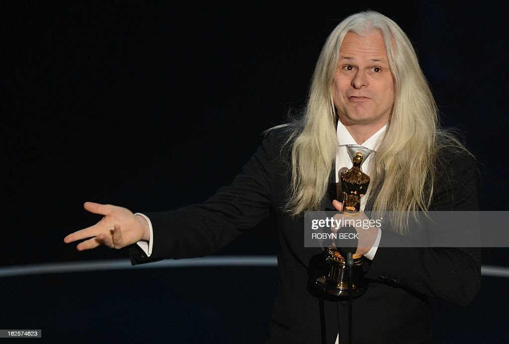 Best Cinematography winner Claudio Miranda hoists the trophy onstage at the 85th Annual Academy Awards on February 24, 2013 in Hollywood, California. AFP PHOTO/Robyn BECK