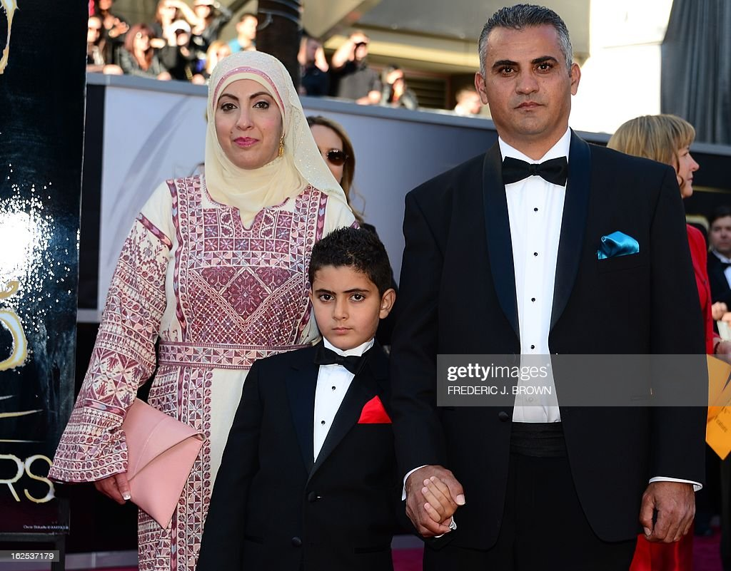 Best Documentary Feature nominee Emad Burnat (R) his wife Soreya and sohn Jibrel arrive on the red carpet for the 85th Annual Academy Awards on February 24, 2013 in Hollywood, California. AFP PHOTO/FREDERIC J. BROWN