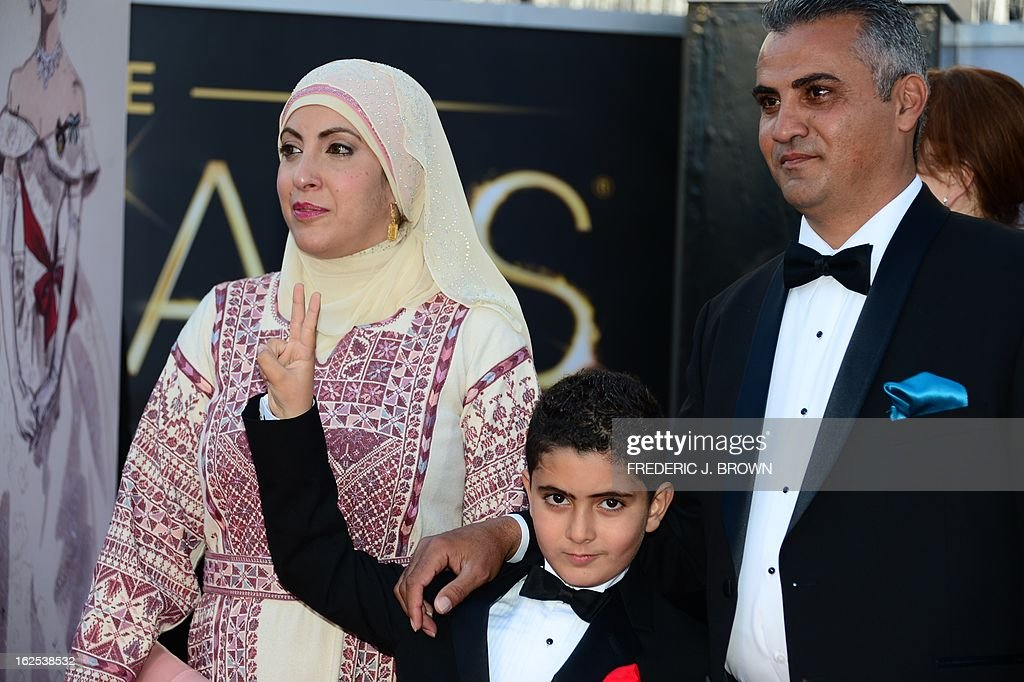 Best Documentary Feature nominee Emad Burnat (R) his wife Soreya and sohn Jibrel arrive on the red carpet for the 85th Annual Academy Awards on February 24, 2013 in Hollywood, California.
