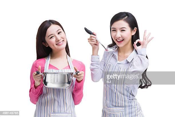 Best female friends doing taste test