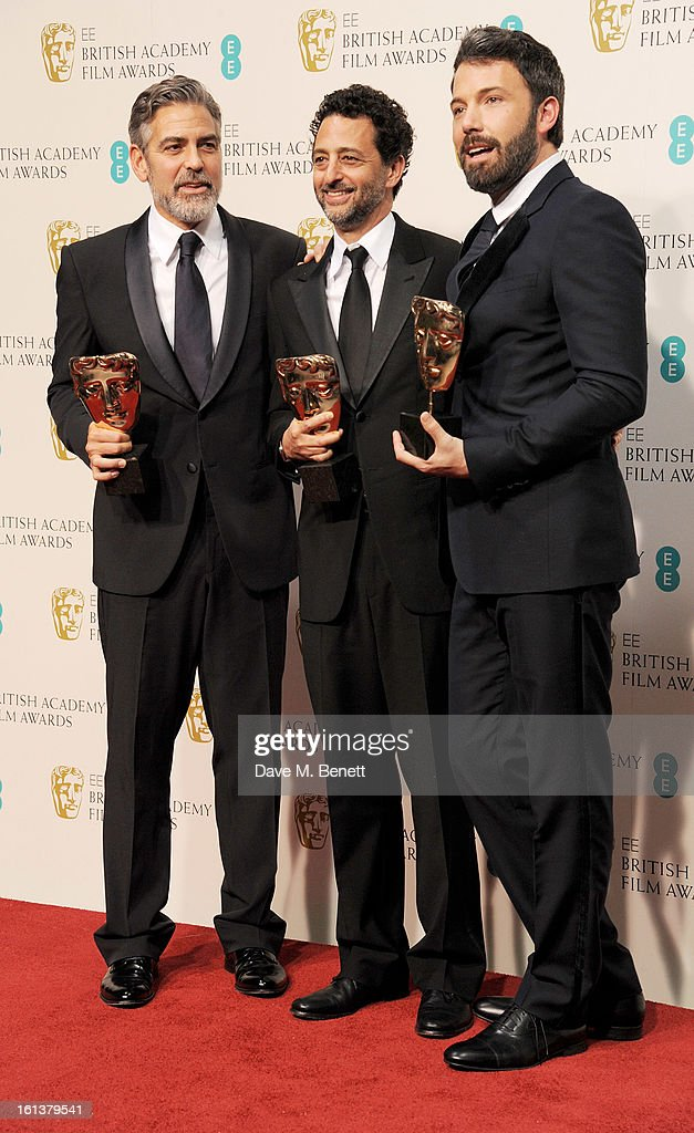 Best Film winners George Clooney Grant Heslov and Ben Affleck pose in the Press Room at the EE British Academy Film Awards at The Royal Opera House...