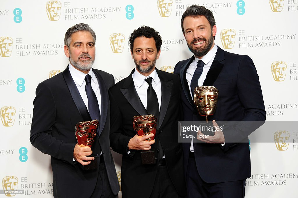 Best Film winners George Clooney Grant Heslov and Ben Affleck pose in the press room at The EE British Academy Film Awards 2013 at The Royal Opera...