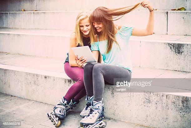 Best friends bonding together and having fun with rollerskates