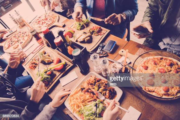 Best friends eating at restaurant table - directly above view