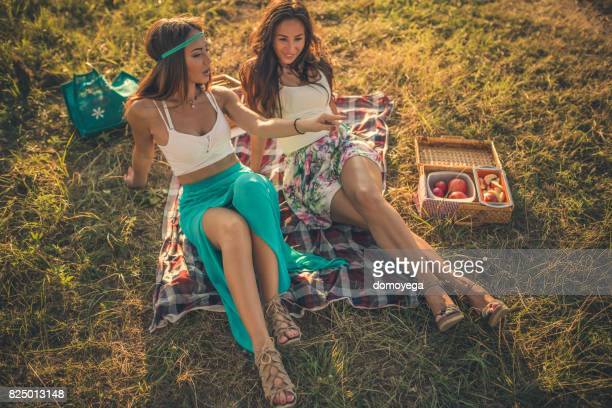 Best friends having picnic and enjoying beautiful day