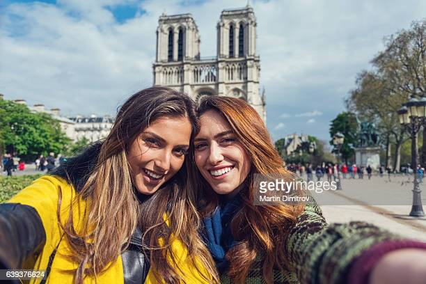 Best friends in Paris taking selfie in the city