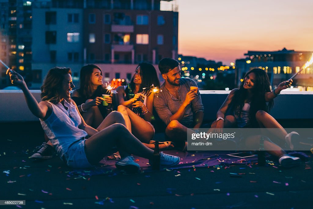 Best friends on a rooftop party : Stock Photo
