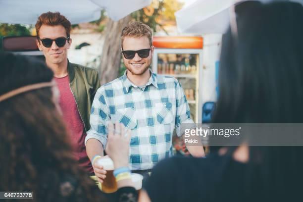 Best friends on the best summer festival drinking beer