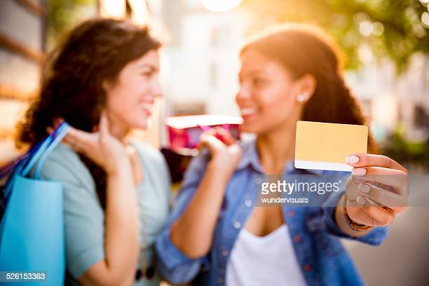 Best Friends Out Shopping With Credit Card
