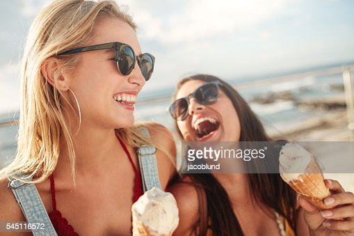 Best friends together outdoors with ice cream : Stock Photo
