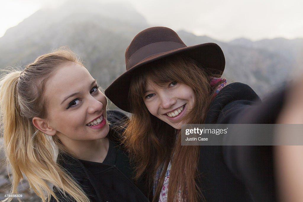 best girl friends taking a selfie in the mountain