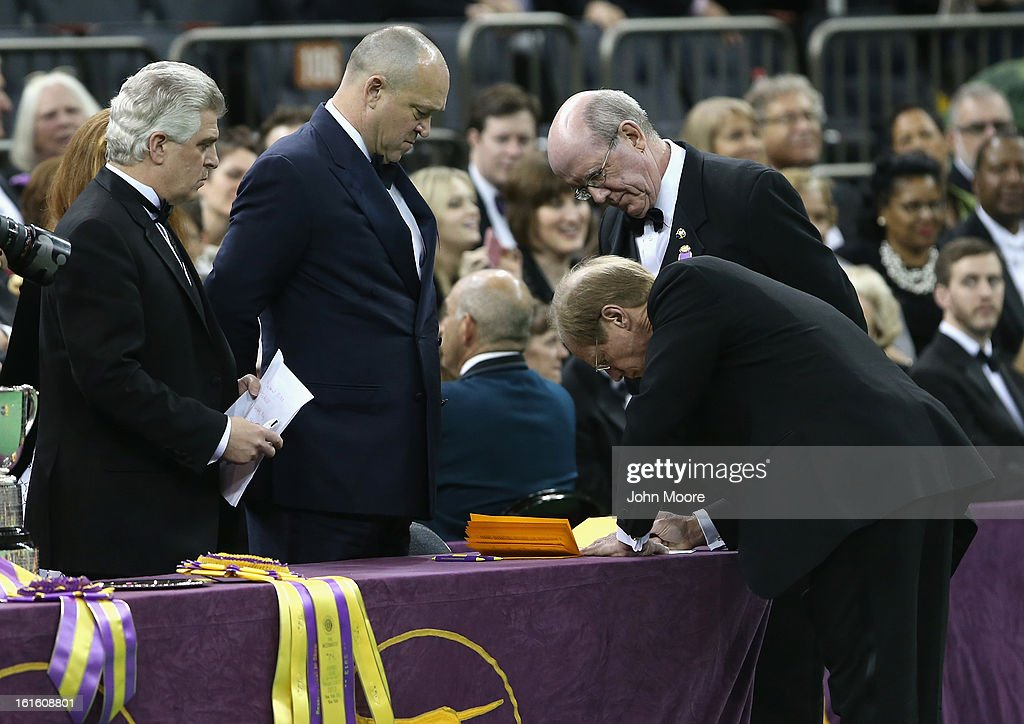 Best in Show judge Michael Dougherty (R), signs the results at the 137th Westminster Kennel Club Dog Show on February 12, 2013 in New York City. A total of 2,721 dogs from 187 breeds and varieties competed in the event, hailed by organizers as the second oldest sporting competition in America, after the Kentucky Derby.
