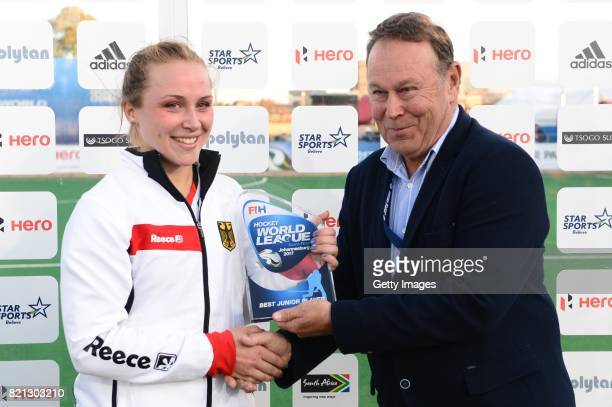 Best Junior Player Nike Lorenz of Germany receives her award form President of the South African Hockey Association Mike Du Plessis during day 9 of...