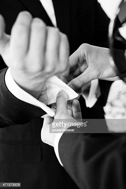 Best Man Helping Groom with Cuff links