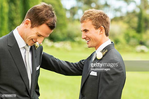 Best Man Looking At Groom In Garden