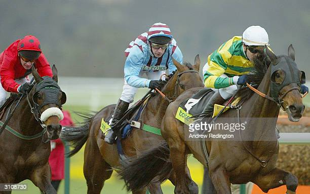 Best Mate ridden by Jim Culloty with Harbour Pilot and First Gold during The Gold Cup on the third day of the annual National Hunt Festival held at...
