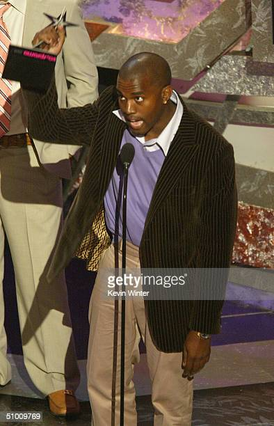 Best New Artist winner Kanye West speaks on stage at the 2004 Black Entertainment Awards held at the Kodak Theatre on June 29 2004 in Hollywood...