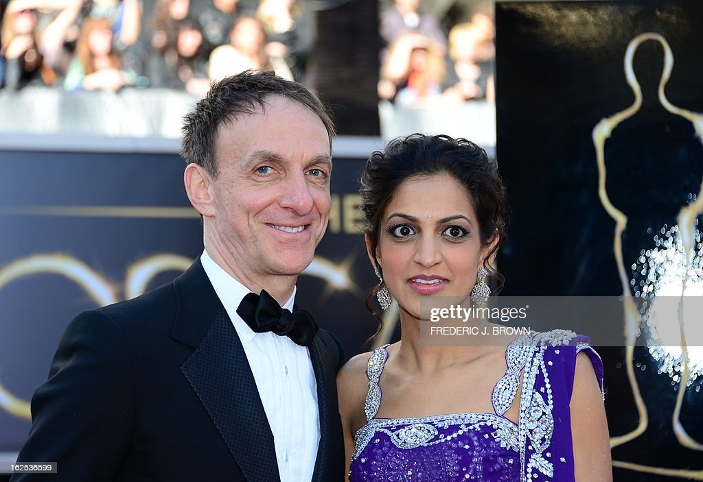 Best Original Score nominee Mychael Danna and his wife Aparna arrive on the red carpet for the 85th Annual Academy Awards on February 24, 2013 in Hollywood, California.