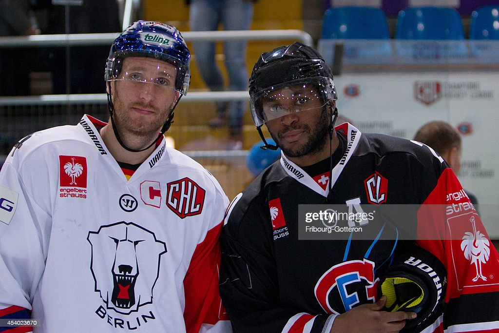 Best players pose for a picture during the group stage match between Fribourg-Gotteron and Eisbaeren Berlin on August 23, 2014 in Fribourg, Switzerland.