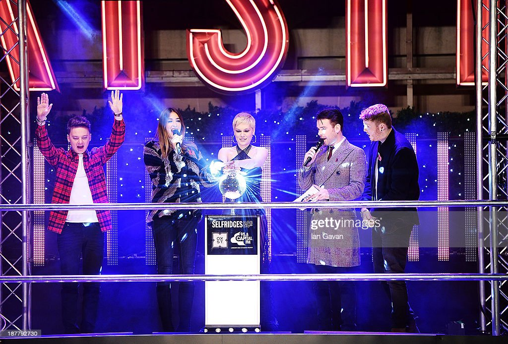 Best selling artist <a gi-track='captionPersonalityLinkClicked' href=/galleries/search?phrase=Jessie+J&family=editorial&specificpeople=5737661 ng-click='$event.stopPropagation()'>Jessie J</a> switches on the Oxford Street Christmas lights at Selfridges with James Arthur and <a gi-track='captionPersonalityLinkClicked' href=/galleries/search?phrase=Conor+Maynard&family=editorial&specificpeople=8899313 ng-click='$event.stopPropagation()'>Conor Maynard</a> to crowd 10,000 on Oxford Street on November 12, 2013 in London, England.