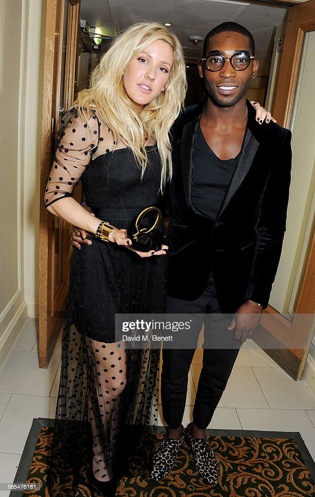 Best Solo Act winner <a gi-track='captionPersonalityLinkClicked' href=/galleries/search?phrase=Ellie+Goulding&family=editorial&specificpeople=6389309 ng-click='$event.stopPropagation()'>Ellie Goulding</a> (L) and <a gi-track='captionPersonalityLinkClicked' href=/galleries/search?phrase=Tinie+Tempah&family=editorial&specificpeople=6742538 ng-click='$event.stopPropagation()'>Tinie Tempah</a> pose in the press room at The Q Awards at The Grosvenor House Hotel on October 21, 2013 in London, England.