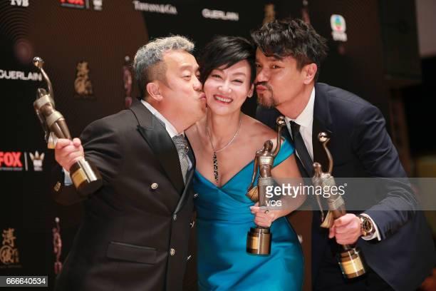 Best Supporting Actor award winner Eric Tsang Best Actress award winner Kara Wai and Best Actor award winner Lam Ka Tung celebrate at the backstage...