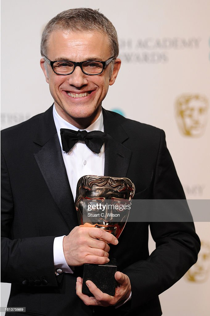 Best Supporting Actor Christoph Waltz poses in the press room at the EE British Academy Film Awards at The Royal Opera House on February 10, 2013 in London, England.