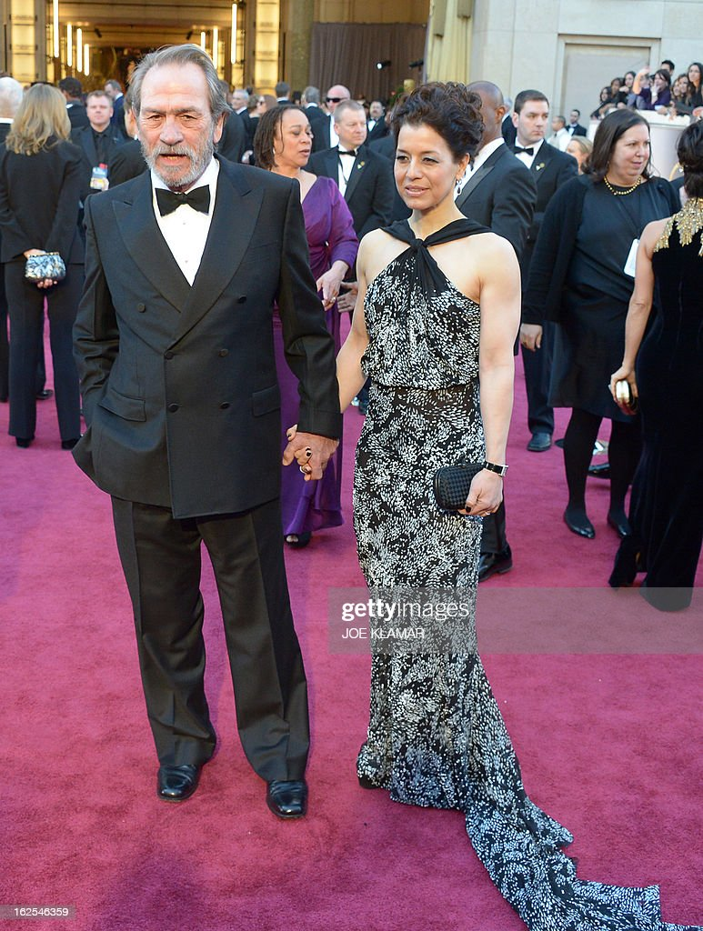 Best Supporting Actor nominee Tommy Lee Jones arrives with his wife Dawn Laurel Jones on the red carpet for the 85th Annual Academy Awards on February 24, 2013 in Hollywood, California.