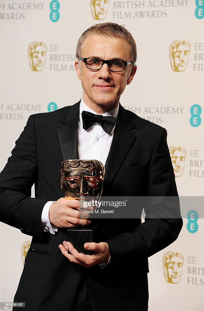 Best Supporting Actor winner Christoph Waltz poses in the Press Room at the EE British Academy Film Awards at The Royal Opera House on February 10, 2013 in London, England.