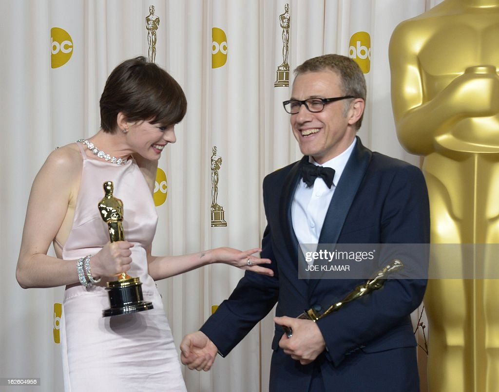 Best Supporting Actress Anne Hathaway celebrates with Best Supporting Actor Christoph Waltz in the press room during the 85th Academy Awards on February 24, 2013 in Hollywood, California. AFP PHOTO / Joe KLAMAR