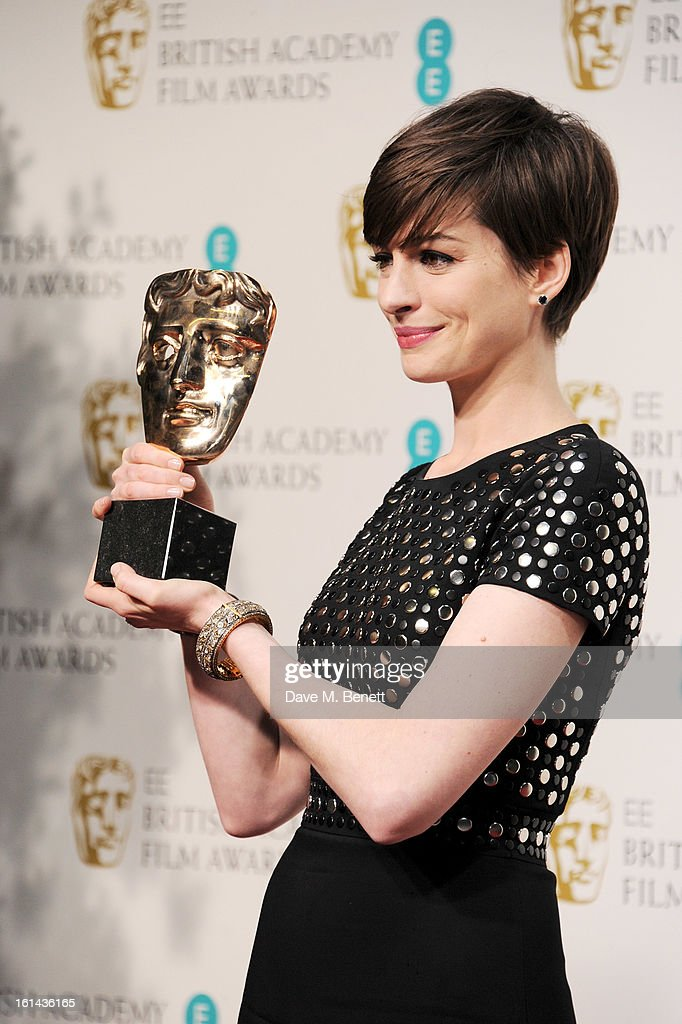 Best Supporting Actress winner Anne Hathaway poses in the Press Room at the EE British Academy Film Awards at The Royal Opera House on February 10, 2013 in London, England.