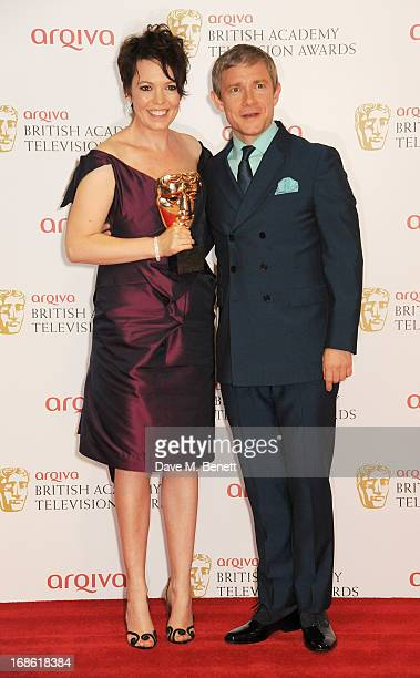 Best Supporting Actress winner Olivia Colman and Martin Freeman pose in the press room at the Arqiva British Academy Television Awards 2013 at the...