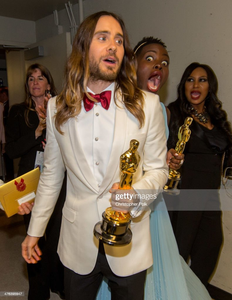 Best Supporting <a gi-track='captionPersonalityLinkClicked' href=/galleries/search?phrase=Jared+Leto&family=editorial&specificpeople=214764 ng-click='$event.stopPropagation()'>Jared Leto</a> pose backstage with Best Supporting Actress winner <a gi-track='captionPersonalityLinkClicked' href=/galleries/search?phrase=Lupita+Nyong%27o&family=editorial&specificpeople=10961876 ng-click='$event.stopPropagation()'>Lupita Nyong'o</a> during the Oscars held at Dolby Theatre on March 2, 2014 in Hollywood, California.