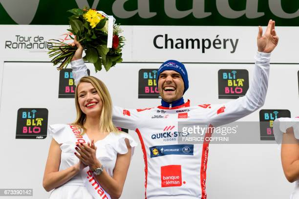 Best young cyclist Germany's Maximilian Schachmann of team QuickStep Floors reacts during the podium ceremony of the first stage of Tour de Romandie...