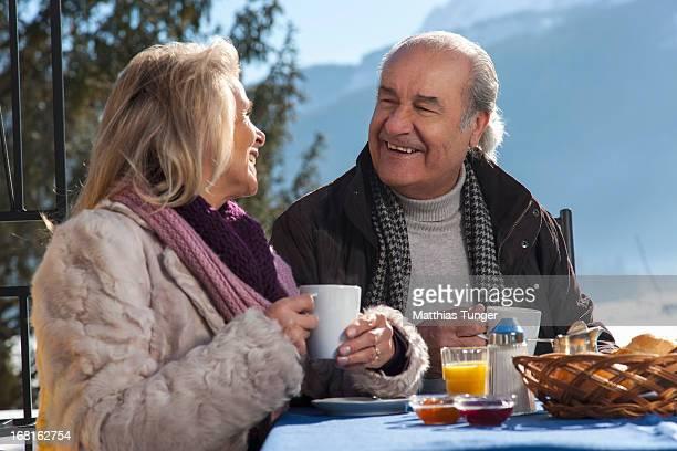 Bestager couple having breakfast outside the hotel