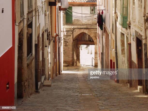 Betanzos. Typical narrow street of the city that ends at one of its entrance doors.
