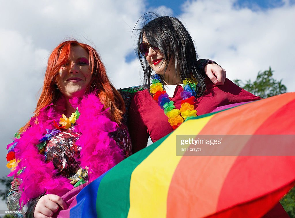 Beth Baxter, 29 from Middlesbrough and Rachael Hall, 28 from Stockton prepare to take part in a parade during a Community Pride event on September 14, 2013 in Middlesbrough, England. The parade was the culmination of a three day event to raise awareness and celebrate Lesbian, Gay, Bi-sexual and Transgender life.