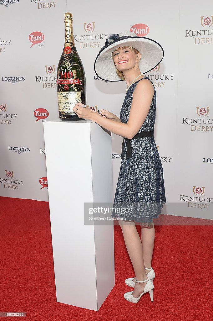 Beth Beher toasts with Moet & Chandon at the 140th Kentucky Derby at Churchill Downs on May 3, 2014 in Louisville, Kentucky.