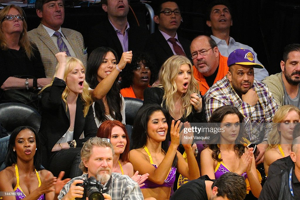 <a gi-track='captionPersonalityLinkClicked' href=/galleries/search?phrase=Beth+Behrs&family=editorial&specificpeople=6556378 ng-click='$event.stopPropagation()'>Beth Behrs</a> (L) and Fergie attend the Los Angeles Lakers and Denver Nuggets game 7 of the Western Conference Quarterfinals in the 2012 NBA Playoffs on May 18, 2012 in Los Angeles, California.