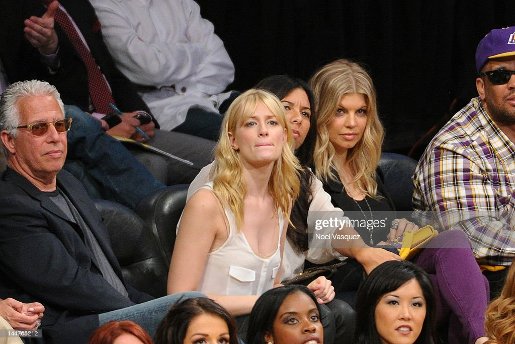 Beth Behrs (L) and Stacy Ferguson attend the Los Angeles Lakers and Denver Nuggets game 7 of the Western Conference Quarterfinals in the 2012 NBA Playoffs on May 18, 2012 in Los Angeles, California.