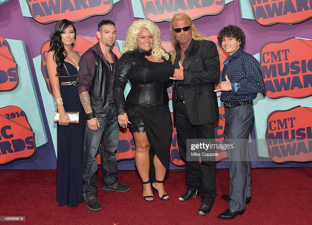 <a gi-track='captionPersonalityLinkClicked' href=/galleries/search?phrase=Beth+Chapman&family=editorial&specificpeople=2131379 ng-click='$event.stopPropagation()'>Beth Chapman</a>, Duane 'Dog' Chapman, and guests attend the 2014 CMT Music awards at the Bridgestone Arena on June 4, 2014 in Nashville, Tennessee.