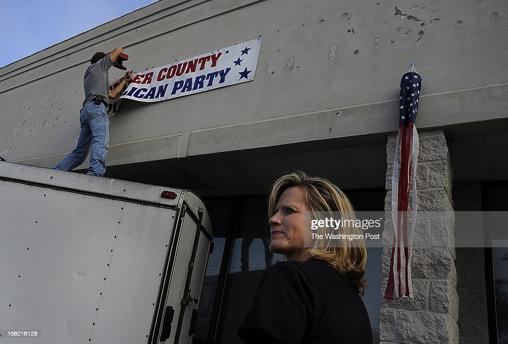 Beth Cox spent two days clearing out and cleaning a rented office space for the Sumner County Republican headquarters just after the election. (L) Volunteer Gary Hunt takes down the banner that had adorned the building. She is a Christian Republican who felt disappointed and discouraged by the result of the presidential election.(Photo by Michael S. Williamson/The Washington Post via Getty Images