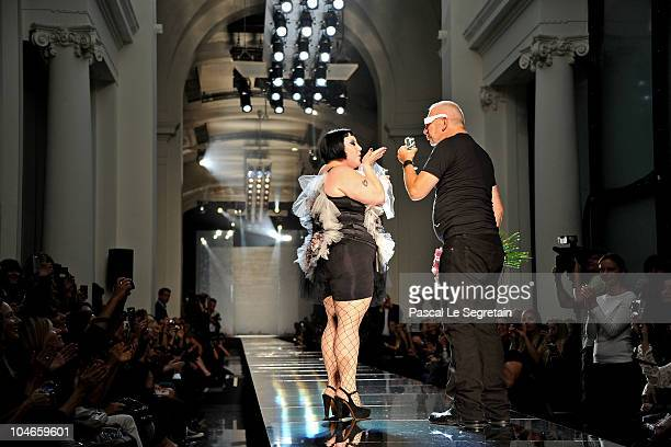 Beth Ditto and designer Jean Paul Gaultier walk the runway during the Jean Paul Gaultier Ready to Wear Spring/Summer 2011 show during Paris Fashion...