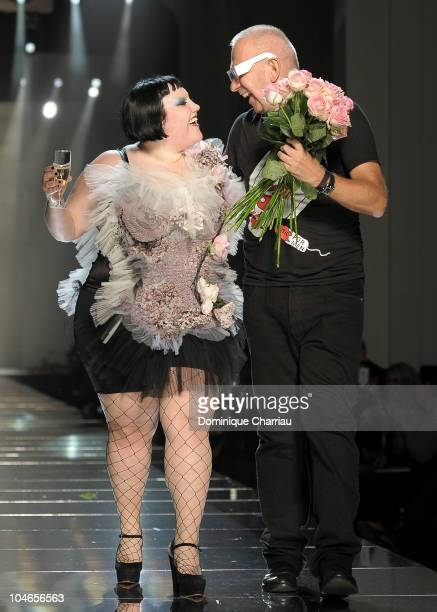 Beth Ditto and JeanPaul Gaultier walk the runway during the Jean Paul Gaultier Ready to Wear Spring/Summer 2011 show during Paris Fashion Week on...