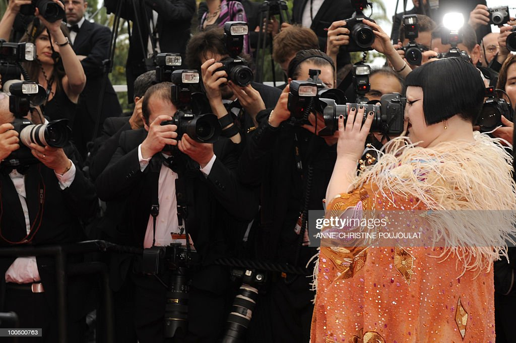Beth Ditto of the US, lead singer of 'The Gossip,' uses a photographers camera as she arrives for the screening of 'Hors La Loi' (Outside of the Law) presented in competition at the 63rd Cannes Film Festival on May 21, 2010 in Cannes.
